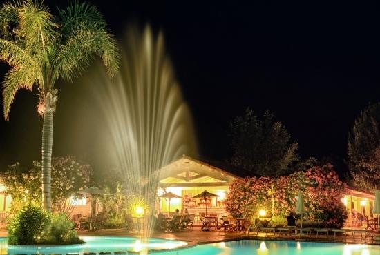 Resort lights illuminate the pool