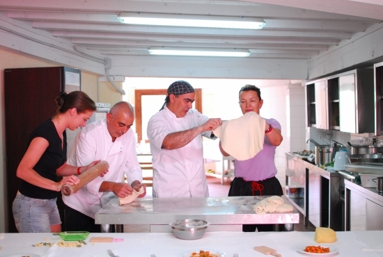 Chefs help guests to prepare the dough